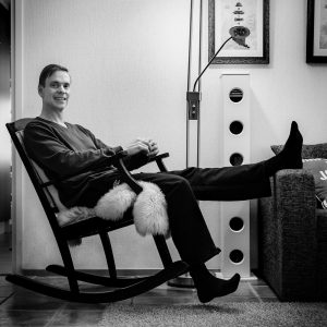man sitting in a rocking chair